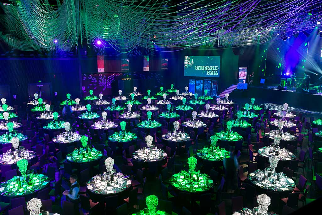 Event room full of green and white tables - event photography